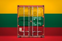 The transporting container with the national flag. The concept of  Lithuania export-import, container transporting and national delivery of goods. The royalty free stock images