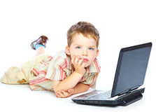 Concept of little businessman. Little child and laptop. Isolated on white background Stock Image