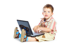 Concept of little businessman. Little child and laptop. Isolated on white background Royalty Free Stock Photo