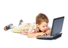 Concept of little businessman. Little child and laptop. Isolated on white background Stock Photo