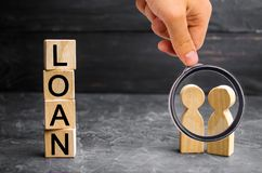 The concept of `Loan`. Businessmen are discussing questions about the company`s loans. The financial loans between the lender and. The borrower. Secured and royalty free stock photos