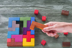 The concept of logical thinking. Wooden geometric shapes. Royalty Free Stock Photos