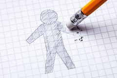 Concept. Loss of hands, amputation. Drawing with pencil of man with an erased hand.  royalty free stock photos