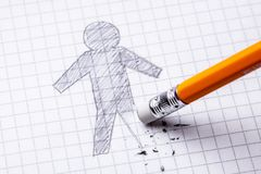 Concept. Loss of leg, amputation. Drawing with pencil of man with an erased leg.  royalty free stock photos