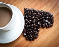 Concept of love with coffee beans. Concept of love with coffee beans on wood texture Royalty Free Stock Image