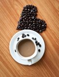 Concept of love with coffee beans. Concept of love with coffee beans on wood texture Stock Photos