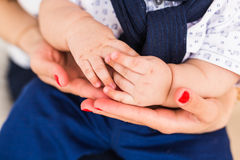 Concept of love and family. Hands of mother and baby closeup Stock Images