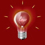 Concept of love in the form of light bulb on a red background. Stock Images