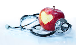 Concept of love for health. Apple with stethoscope Royalty Free Stock Images