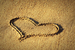 Concept of love.  heart in the sand Stock Photos