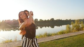 Concept of love and relationships Couple dancing bachata at sunset. Concept of love and relationships Young Couple dancing bachata at sunset stock video