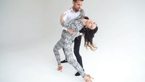 Concept of love, relationships and social dancing. Social dance, salsa, zouk, tango, kizomba concept - beautiful couple stock video