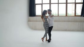 Concept of love, relationships and social dancing. Social dance, salsa, zouk, tango, kizomba concept - beautiful couple stock video footage