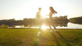 Concept of love and relationships. Young couple dancing at sunset. Concept of love and relationships. Young couple dancing at summer sunset stock footage