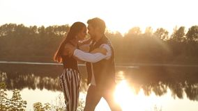 Concept of love and relationships. Young couple dancing at sunset. Concept of love and relationships. Young couple dancing at summer sunset stock video