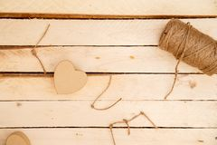 Concept for love stories and for Valentine`s Day. Female hands make boxes in the form of a heart and the inscription `love` from a. Rope. View from above royalty free stock photos