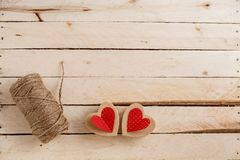 Concept for love stories and for Valentine`s Day. The string, the inscriptions from it and handmade cardboard hearts on a natural royalty free stock images