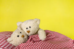 Concept for love - two toy teddy bears in the bed. Royalty Free Stock Image