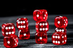 Concept luck - dice gambling on dark wooden background.  royalty free stock photography