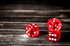 Concept luck - dice gambling on dark wooden background.  royalty free stock photos