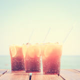 Concept of luxury tropical vacation. Three Cuba Libre cocktails Royalty Free Stock Photography