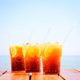 Concept of luxury tropical vacation. Three Cuba Libre cocktails Stock Photography