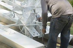 Concept machanic de jet de peinture de difficulté de vitesse de bicyclette de travail d'homme photographie stock