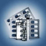 Concept of madicine. Pills, vial, ampoule and syringe on blue ba. Ckground. 3d Royalty Free Stock Photography