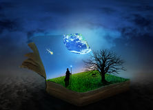 Concept of magic book covered with grass and tree. Stock Photo