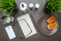 Concept of making notes in a notebook on a small table in a cafe royalty free stock images