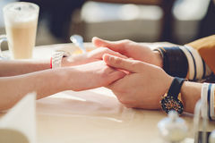 Concept of male and female hands love and coffee. Royalty Free Stock Images