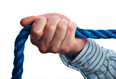 Concept male hand on blue rope on white. Photo concept male hand on blue rope on white Stock Photography