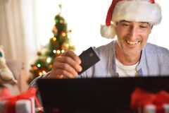 Free Concept Man Buying Christmas Gifts Online At Home With Card Royalty Free Stock Photo - 203224155