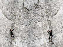 Concept of man climbing rocky mountain. Stock Image