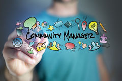 Concept of man drawing community manager title and multimedia ic Stock Photos