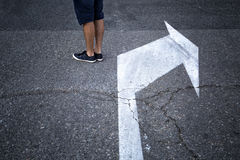 Concept man feet and intersection choice sign Stock Photography