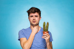 Concept with a man holding a cactus stock images