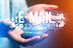 Concept of man holding futuristic interface with e-mail title an Royalty Free Stock Photo