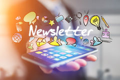 Concept of man holding futuristic interface with newsletter titl. E and multimedia icons flying all around - Internet concept Stock Photos