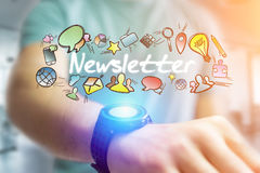 Concept of man holding futuristic interface with newsletter titl. E and multimedia icons flying all around - Internet concept Royalty Free Stock Photography