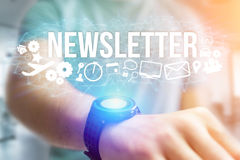 Concept of man holding futuristic interface with newsletter titl. Concept view of man holding futuristic interface with newsletter title and multimedia icons Royalty Free Stock Photography