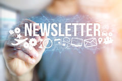 Concept of man holding futuristic interface with newsletter titl. Concept view of man holding futuristic interface with newsletter title and multimedia icons Stock Image