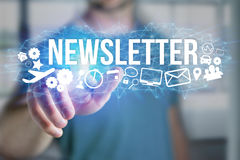 Concept of man holding futuristic interface with newsletter titl. Concept view of man holding futuristic interface with newsletter title and multimedia icons Stock Photos