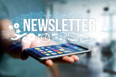 Concept of man holding futuristic interface with newsletter titl. Concept view of man holding futuristic interface with newsletter title and multimedia icons Stock Images