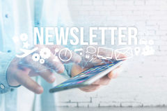 Concept of man holding futuristic interface with newsletter titl. Concept view of man holding futuristic interface with newsletter title and multimedia icons Stock Photo