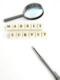 Concept market survey. A conceptual photograph about surveying of the market for target customers.  Taken with magnifying glass and black pen on white background Stock Image