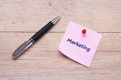 Concept Marketing as word on pink sticky note Royalty Free Stock Photo