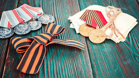 Concept May 9 St.Georges Ribbon medal award blade old photos. Victory Day. May 9. Stock Photos