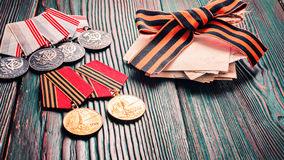 Concept May 9 St.Georges Ribbon medal award blade old photos. Victory Day. May 9. Stock Photography