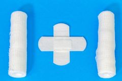 Concept of medical bandage and wound tape. On  background in blue color royalty free stock photos